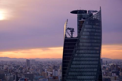 building japan skyscraper sunrise cityscape sony nagoya 日本 名古屋 ビル 日の出 朝焼け 高層ビル apsc モード学園スパイラルタワーズ modegakuenspiraltowers sel55210 e55210mmf4563oss ©jakejung