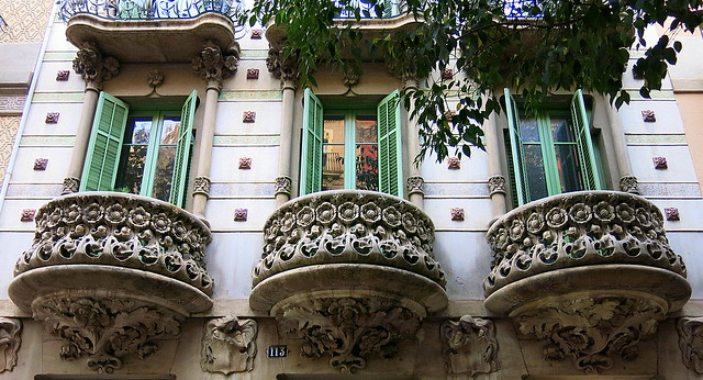 Rounded balconies with floral stonework, Barcelona