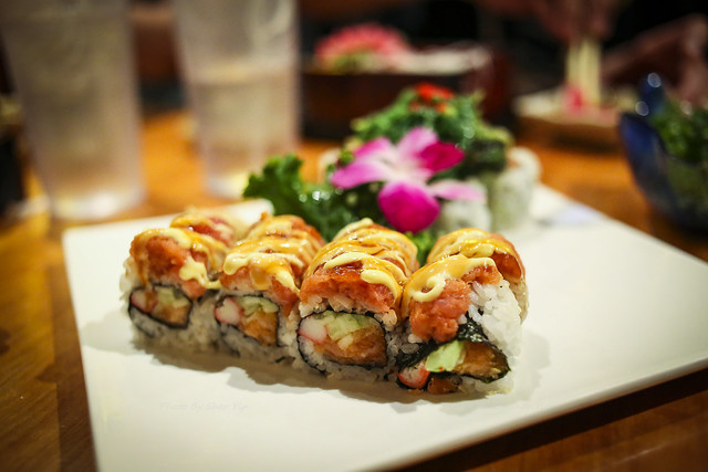 Maki with Spicy Salmon on top, crab meat, cucumber, spicy tuna in middle - Volcano