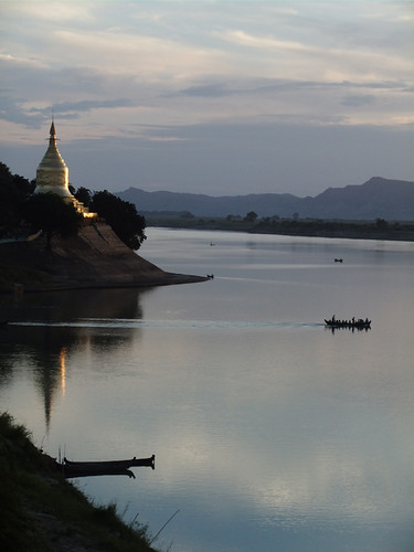 Golden temple on the edge of the Irrawaddy River catching the sunset in Bagan, Myanmar