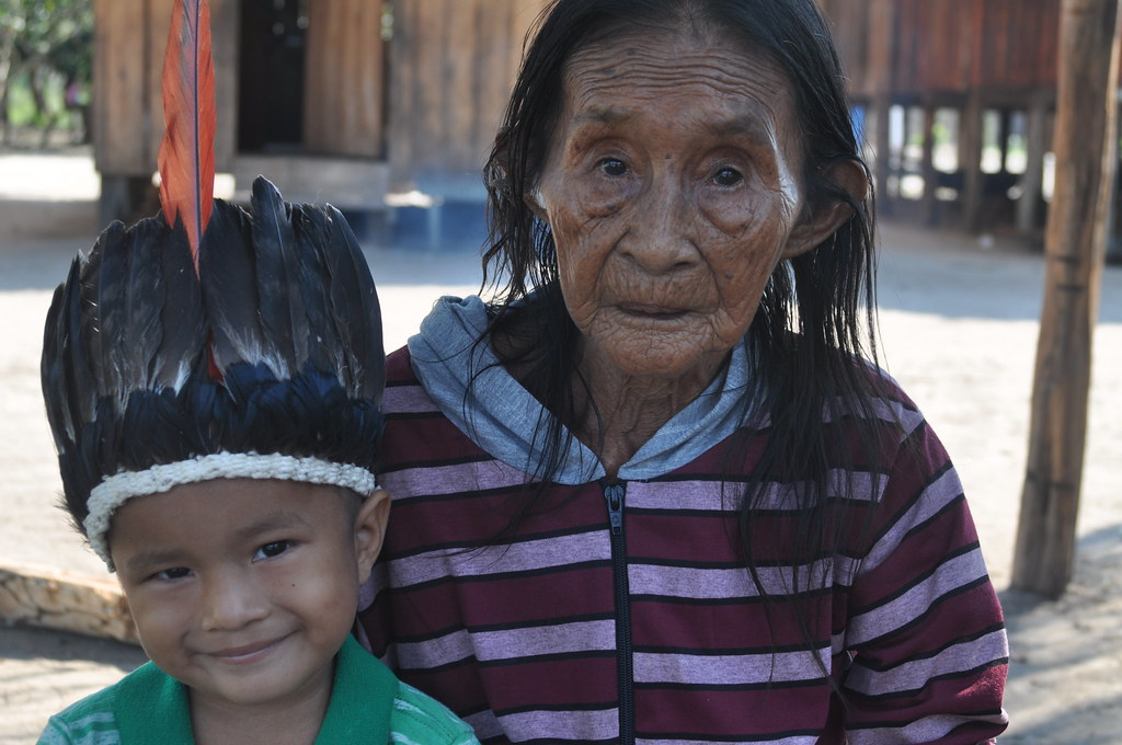 The 90-year-old mother of Ivan Tenharim, the allegedly murdered tribal chief, and her great-grandson.