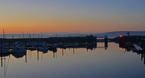 blue orange reflection water sunrise boats coast still llanelli
