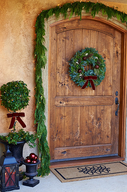 Napa themed Christmas with pine garlands, wreath and glass ball ornaments in front of wooden door