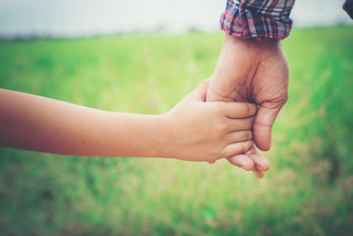 Close up of father holding his daughter hand, so sweet,family time. | by catpeople28