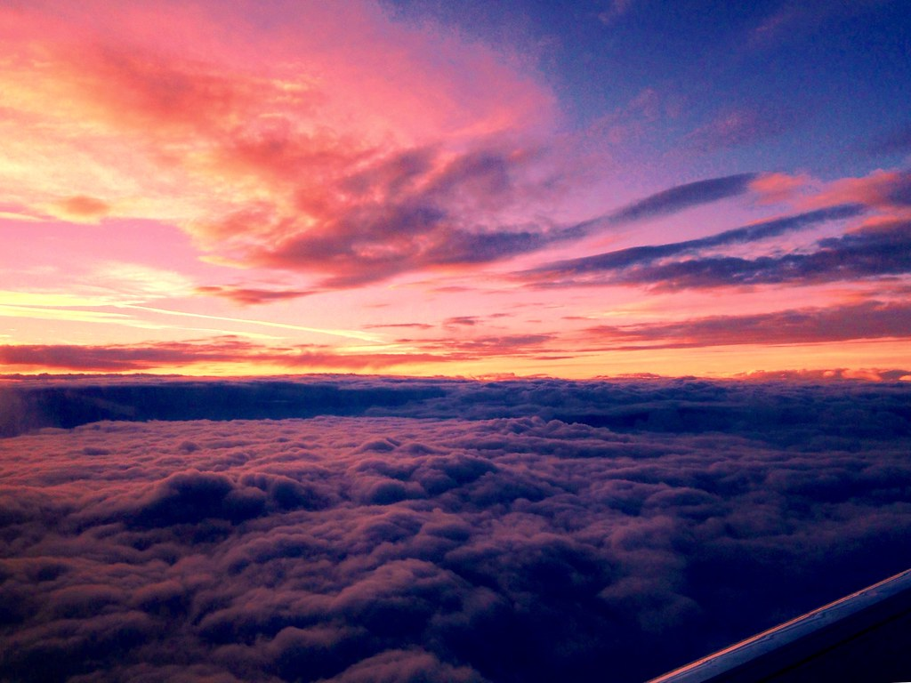 Sunset From An Airplane Window Sunset Over The Cloud Cover Flickr