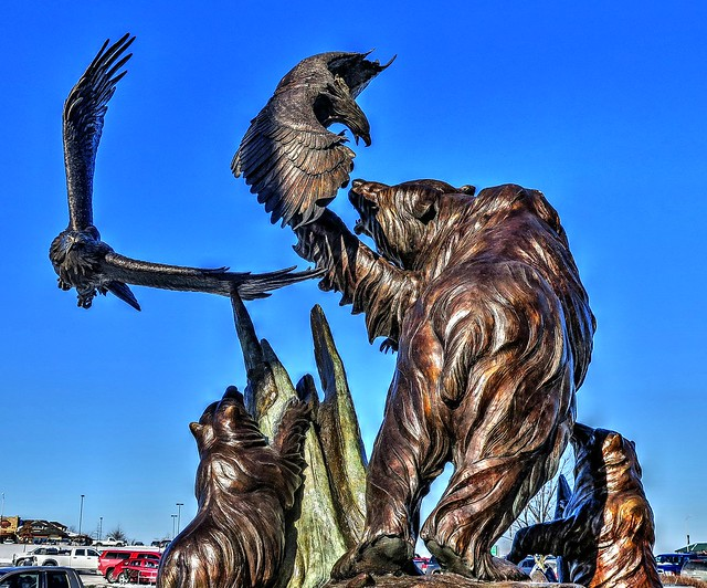 Bronze statue of bears & eagles at Cabela's park lot in West Virginai.