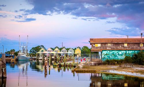 dauphinisland alabama sunset gulfcoast mobilecounty water boathouses shrimpboat marina twilight purple clouds reflections landscape peaceful tranquil calm marine bayou bayoualoe fav10