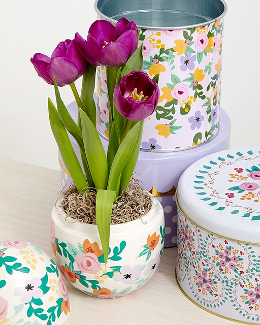 purple potted tulips in an Easter egg pot