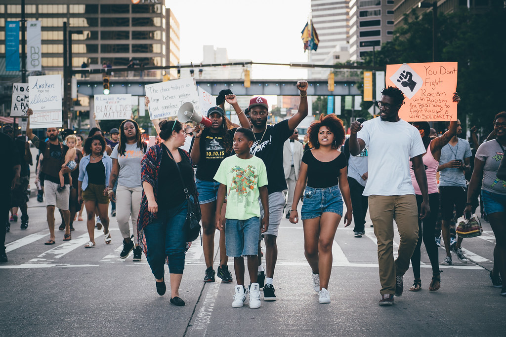 a photo of peaceful protestors at a black lives matter rally
