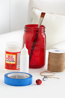 Mason jar centerpiece supplies with tape, white paint and