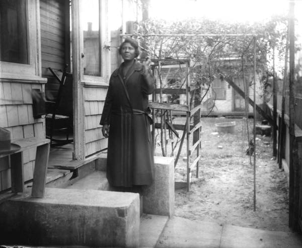 Mattie Smith Forrester outside her clapboard and shingle house - Lincolnville (St. Augustine)