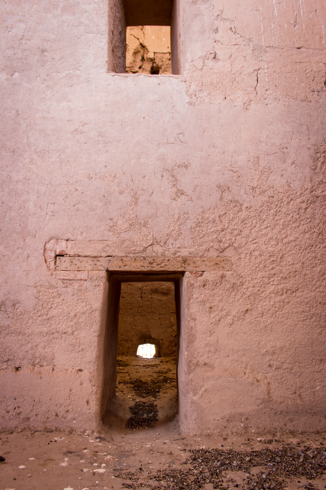 A doorway and a window cut into an earthen wall