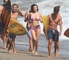 Miranda Kerr wows in a stylish black two-piece as she frolics in Malibu during fun photoshoot