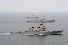 In this file photo, USS John S. McCain (DDG 56) and USS McCampbell (DDG 85), top, move into formation with other U.S. Navy and Republic of Korea Navy ships during exercise Foal Eagle 2013. (U.S. Navy/MC3 Declan Barnes)