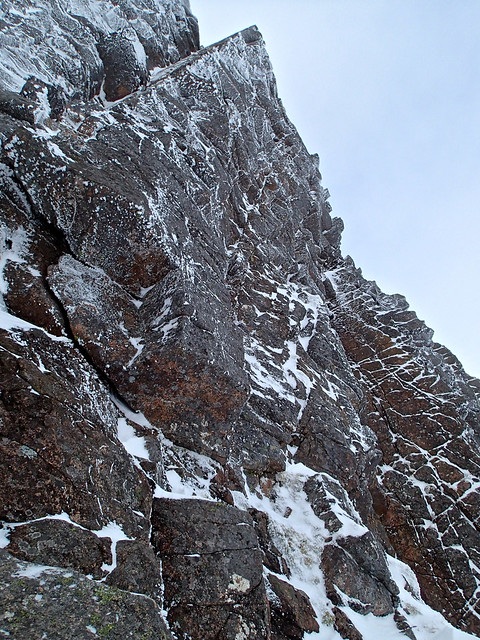 2015/02/25 - 10:17 - Climbs the centre of the overhanging buttress directly.  The groove to the left is Fallout Corner (VI, 7).  The groove to the right is Bavarinthia (IX, 9).  First ascent by Greg Boswell on 2015-02-25.
