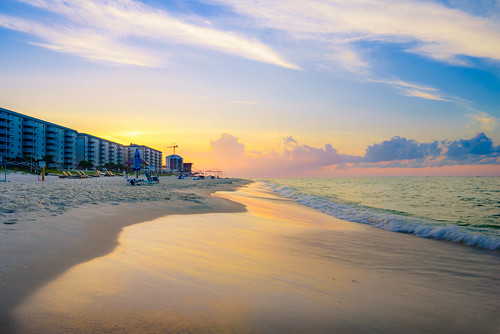 sunshine sand sunrise impressive serene peaceful water florida buildings orangesky oceanview pensacola orange waves view sun blue beach ocean beautiful run sky golden perdidokey colors seascape color travel clouds detail unitedstates us