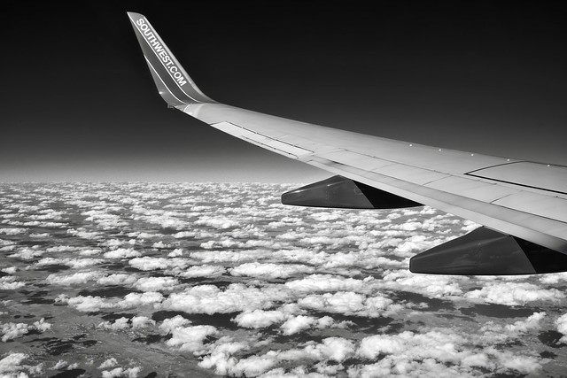 Flying Over Puffy Clouds (Black & White)