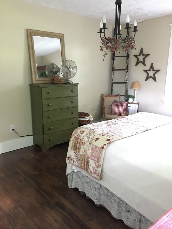 wooden dresser in master bedroom