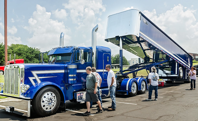 Truck enthusiasts examine HLH Trucking's 2015 Peterbilt 389 with a 2017 MAC End Dump during the 34th annual Shell Rotella SuperRigs truck beauty contest in Joplin Missouri
