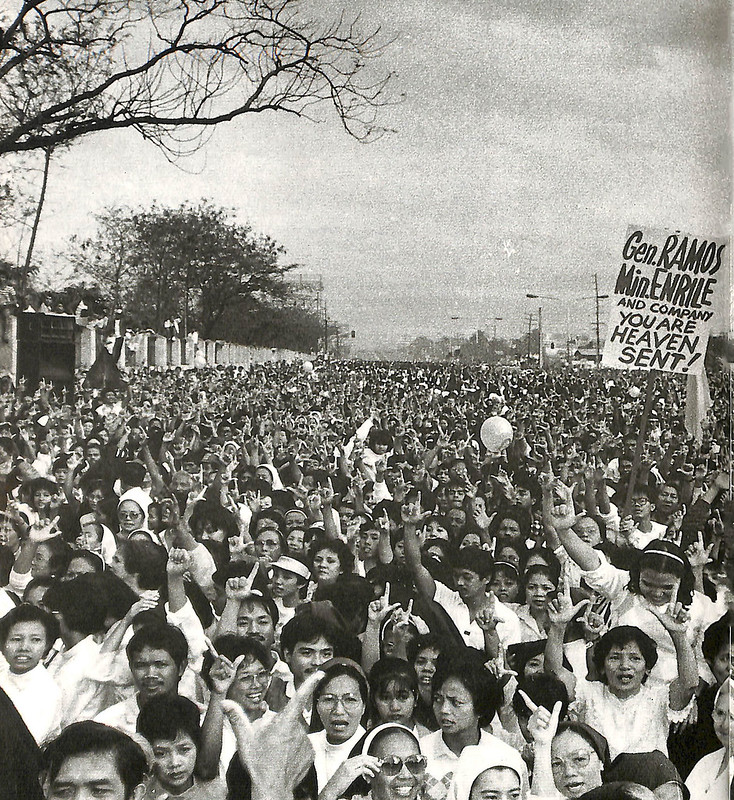 28 February 1986, morning: Thousands hear a Thanksgiving Mass at the main setting of the four-day people's uprising on EDSA itself. Where before, there was a thicket of placards with various messages, there was only one message that morning: gratitude to