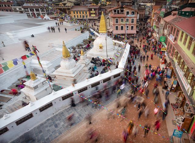 Pilgrims circumabulating Bodhnath Stupa at dusk
