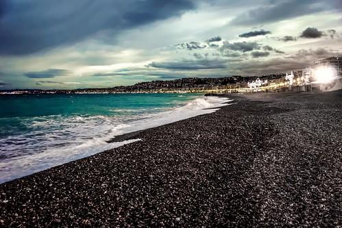 ocean sunset sea france beach water evening nice rocks cloudy