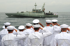 Sailors aboard USS Sampson (DDG 102) salute as the Royal Australian Navy patrol boat HMAS Larrakia (ACPB 84) prepares to lay a wreath during a ceremony commemorating the 73rd anniversary of the Battle of Sunda Strait. (U.S. Navy/MC1 Christopher Perez)