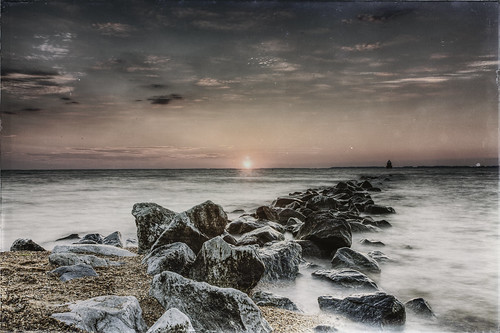 wetplate antiqued sandypoint annapolis maryland chesapeakebay lighthouse jetty beach rocks water sunrise aged slide noise gritty landscape manipulation photoshop longexposure filter clouds sky sliderssunday