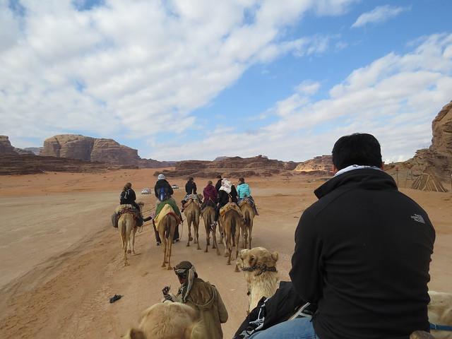 Riding camels in Wadi Rum, Jordan. Pictured: Isaac