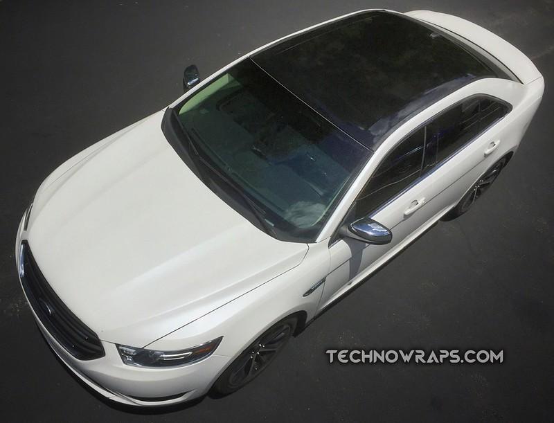 Black vinyl roof wrap on Ford car in Orlando