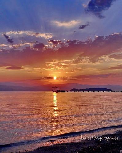 κέρκυρα ανατολή θάλασσα τοπίο corfu landscape sunrise outdoor serene sky beach παραλία ακτή ελλάδα coast