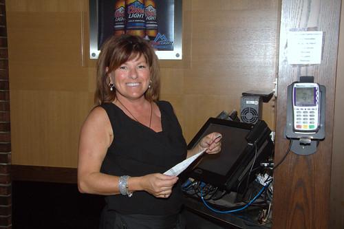 Female Working Holding Receipt / Travailleuse de Purolator tenant un reçu