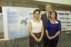 MPH student Roopsi Narayan with CE Chairs Bill Spears and Marietta Orlowski during poster presentation
