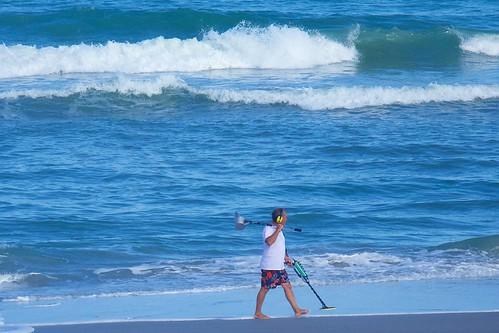 ocean beach walking alone florida sweeper metaldetector indialantic