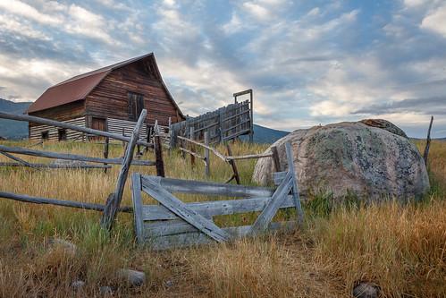 barn mountain sunrise fence boulder rock