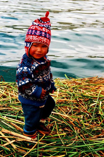little boy uros island peru