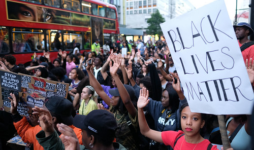 Black Lives Matter protesters in London's Oxford Street kneel and raise their hands - 8 July 2016. | by alisdare1
