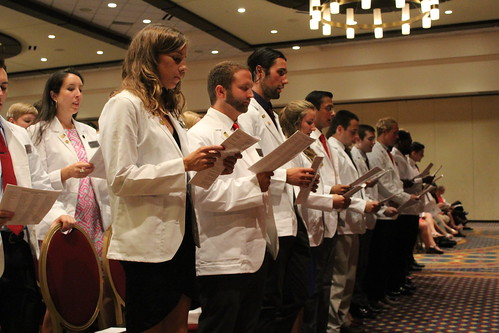 Students recite the Oath of Hippocrates | by Greater Louisville Medical Society