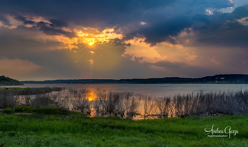 texashillcountry tx texaslakes texas lake canyonlaketexas sunset sunrays orange camping reflection