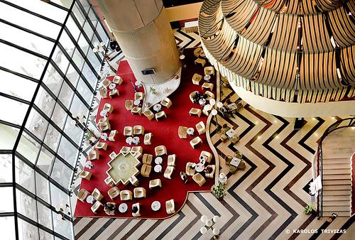 bosniaandherzegovina sarajevo lobby hotel cafe view column stairs chairs tables restaurant carpet red glass lightfixture marble ceiling fountain lanterns