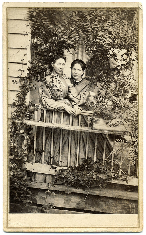 Women on an Ivy-Covered Porch
