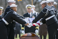 Sailors from The U.S. Navy Ceremonial Guard fold the American flag during the full honors funeral of U.S. Navy Capt. Thomas J. Hudner, April 4. (U.S. Army/Elizabeth Fraser)