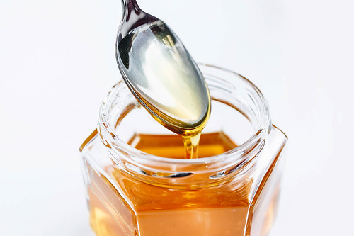 Golden Honey Pouring From The Spoon | by wuestenigel