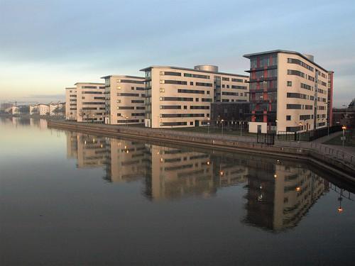 london docks buildings reflections sunrise dawn
