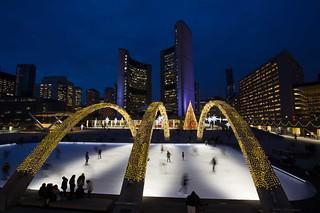 Toronto: Nathan Phillips Square skating rink at night   by The City of Toronto