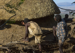 Konso Tribe Men Building A Mora, The Common House, Konso Village, Omo Valley, Ethiopia | by Eric Lafforgue