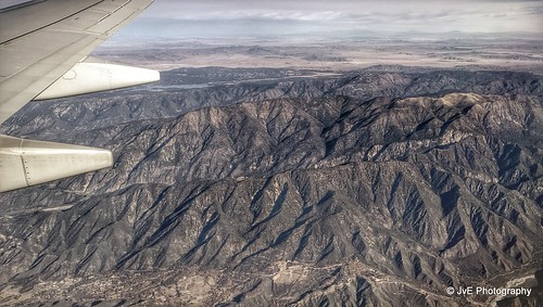 above ca travel blue sky terrain cloud holiday mountains building green window nature field weather plane airplane landscape fly nokia losangeles high airport day ray looking view desert bright earth aircraft aviation flight wing lakes houston atmosphere sunny aerial hills airline rivers land layer phonecamera airliner stratosphere sangabrielmountains birdeye lumia1020 nokialumia1020