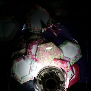 Almost sewing by candlelight.  #epp #paperpiecingeverywhere #sewonthego #beeblock #hexie with my torch light tonight