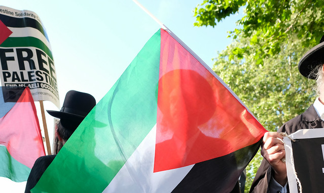 Orthodox Jews with Palestinian Flags Supporting the Palestine Solidarity Campaign.