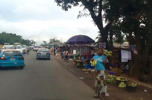 nigeria jujufilms africanculture travel marketscene jujufilmstv photography people womanroadsidehawkingbananasinilara ondo